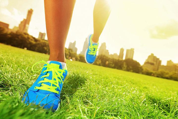 Feet wearing running shoes.