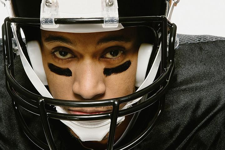 Man wearing a football helmet.