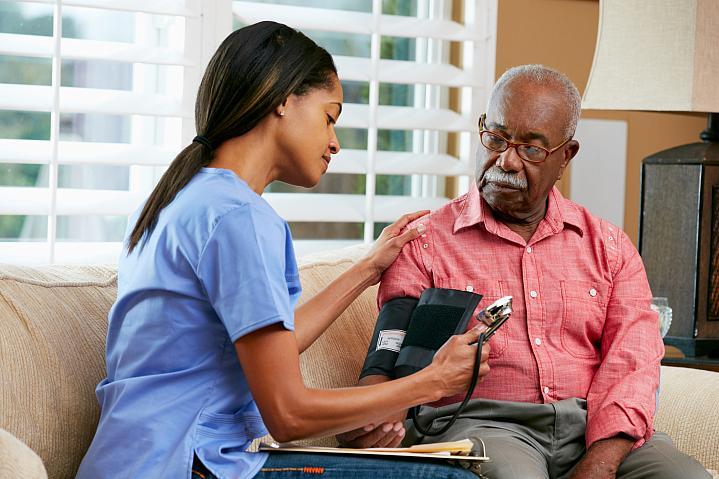 Man getting blood pressure taken.