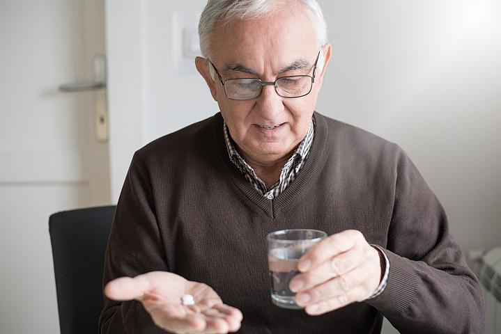 Elderly man with medicine