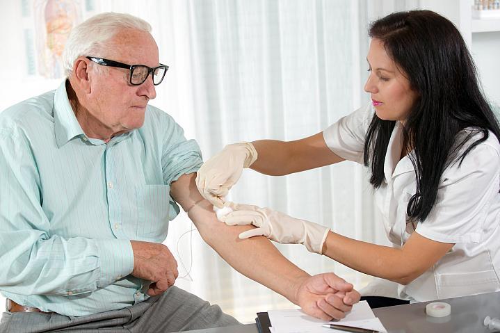 Older man getting his blood drawn