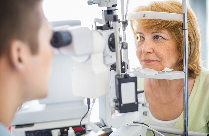 Older woman getting her eyes checked at the eye doctor