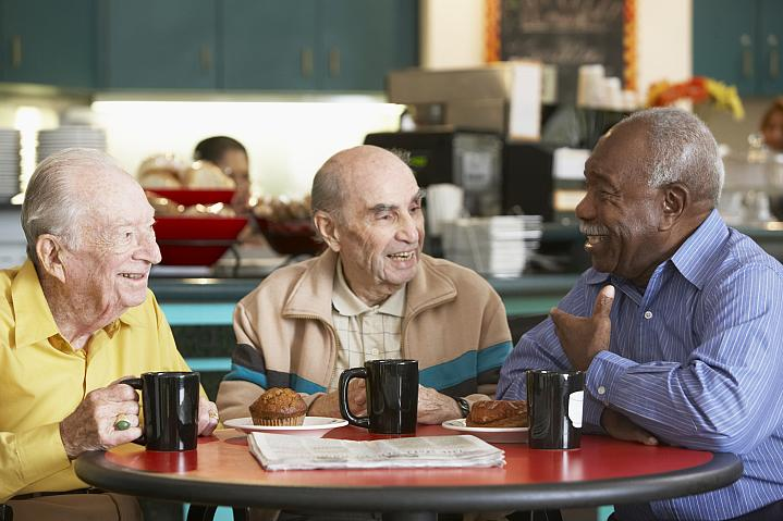 Older adult men drinking tea together